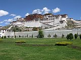 The Potala Palace, perched high above Lhasa on the Marpori (red mountain), is a place of spiritual pilgrimage and a mammoth tribute to Tibetan architectural skills. The name Potala derives from the Sanskrit 'Potalaa', the abode of the Bodhisattva Avalokiteshvara. Unlike most Tibetan monasteries, the Red Guards did not sack the Potala during the Cultural Revolution, and, as a result, all the chapels and their artifacts are remarkably well preserved.